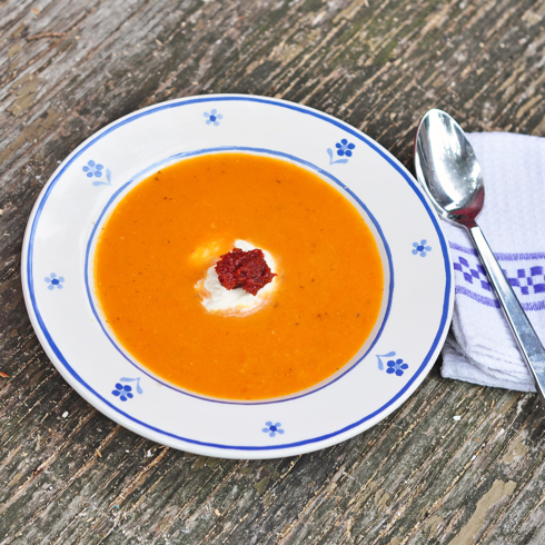 Rustic tomato soup topped with creme fraiche and red pesto recipe