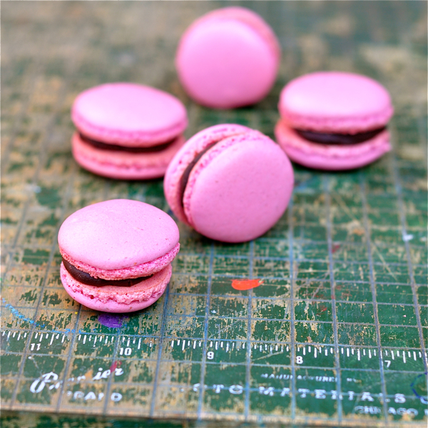 Raspberry macarons with chocolate ganache on eatlivetravelwrite.com