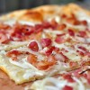 Up close tarte flambee with Liberte Greek yogurt on eatlivetravelwrite.com