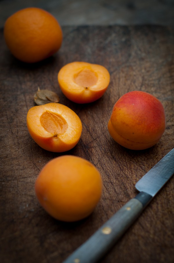 Freshly cut apricots on cutting board