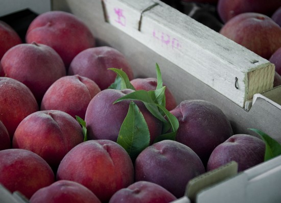 Peaches at Nerac market on eatlivetravelwrite.com