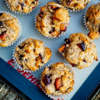 plum poppyseed muffins from The Smitten Kitchen Cookbook on a baking tray