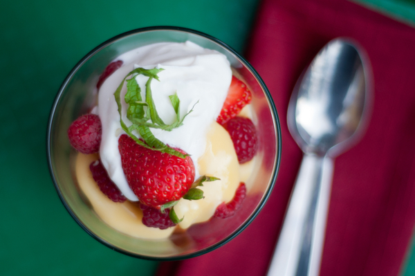 Individual trifles made with fruit brandy in a small glass serving dish
