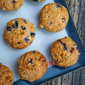 Granola muffins with cranberries and blueberries made with Kimberlys Own Granola on eatlivetravelwrite.com