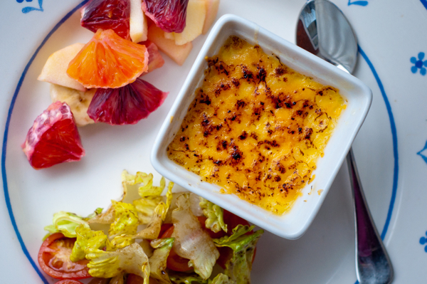 Cheesy Creme Brulees with fruit salad and garden salad
