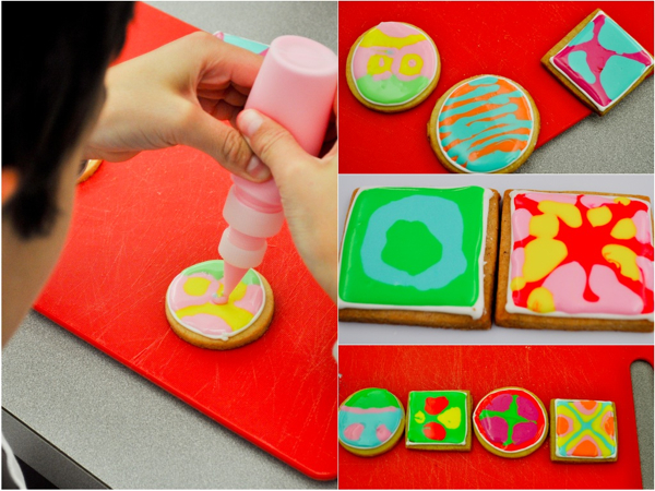 Adell Shneer shows les Petits Chefs how to decorate cookies with royal icing