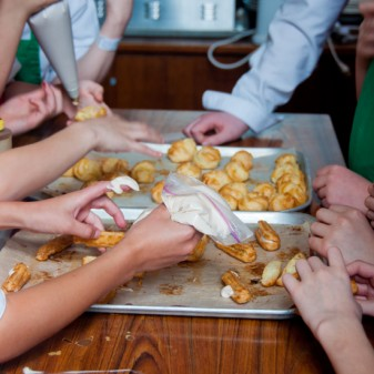 Baking with kids filling cream puffs by eat. live. travel. write.