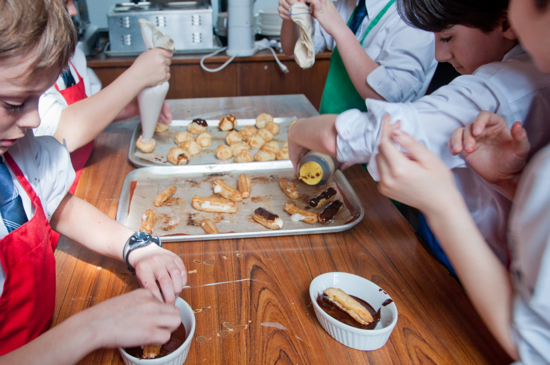 Baking with kids filling eclairs and cream puffs by eat. live. travel. write.