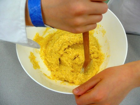 Kids mixing tamale filling with Rossy Earle by eatlivetravelwrite.com