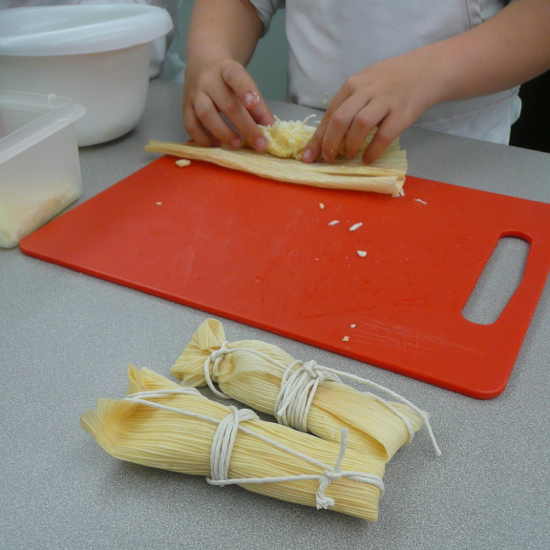 Kids making tamales by eatlivetravelwrite.com