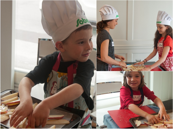 Cooking with kids oiling potatoes for baking