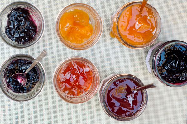 Mason jars and tablespoons of preserves Mardi Michels eatlivetravelwrite.com