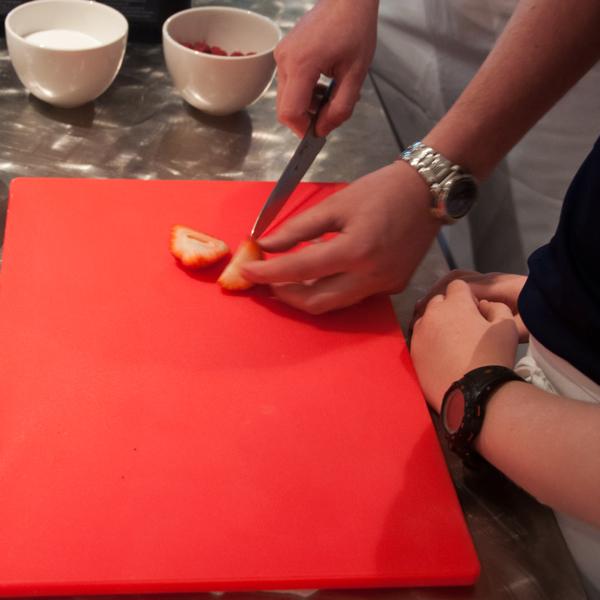 Cutting strawberries cooking with kids Mardi Michels eatlivetravelwrite.com