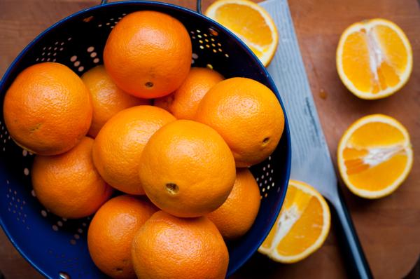 Oranges on a cutting board Mardi Michels eatlivetravelwrite.com