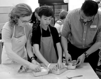 Families cooking dinner together for Food Revolution Day 2013 by Mardi Michels eatlivetravelwrite.com