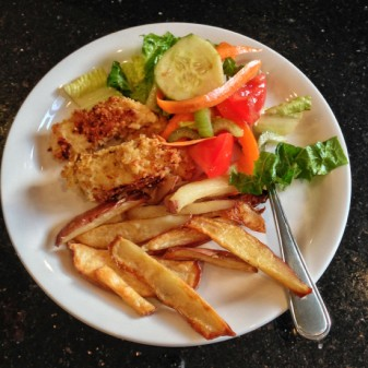 Real food dinner for Food Revolution Day 2013 crunchy garlicky chicken and oven baked potato wedges with salad by Mardi Michels eatlivetravelwrite.com