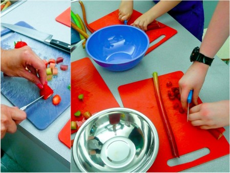 Emily Richards showing Les Petits Chefs how to cut strawberries and rhubarb Mardi Michels eatlivetravelwrite.com