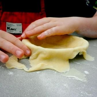 Kids working with pie crust Mardi Michels eatlivetravelwrite.com