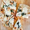 Grilled pizza using Jennifer Perillos dough with mozarella oilve oil and basil Mardi Michels eatlivetravelwrite.com