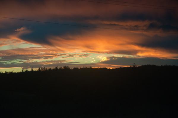 Fiery sunrise on VIA Rail Canadian on eatlivetravelwrite.com