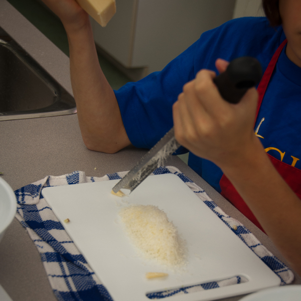 Kids grating cheese on eatlivetravelwrite.com