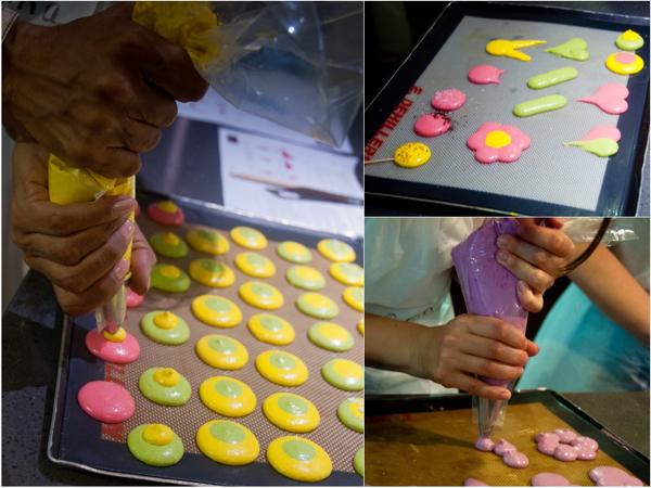 Piping multicoloured macarons at La Cuisine Paris on eatlivetravelwrite.com