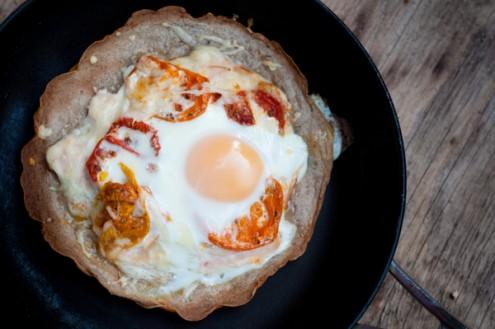 Crispy buckwheat crepe with tomato chicken cheese and egg on eatlivetravelwrite.com