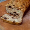 Banana bread loaf with chocolate chips on eatlivetravelwrite.com