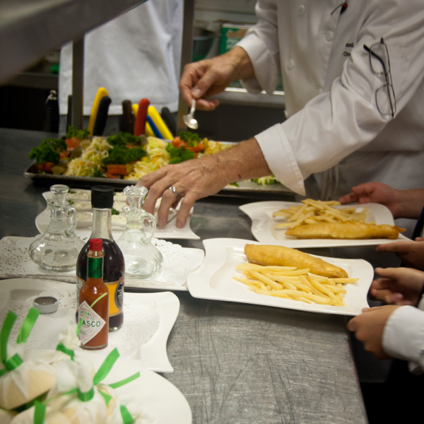 Plating up fish and chips at The National Club on eatlivetravelwrite.com