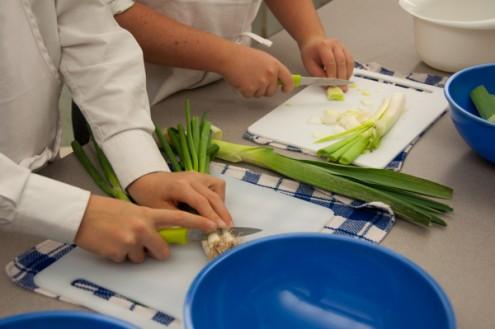 Kids chopping leeks on eatlivetravelwrite.com