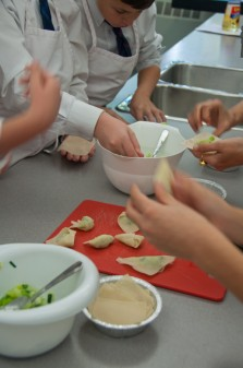 Kids filling dumplings on eatlivetravelwrite.com