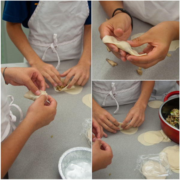 Kids assembling shiitake mushroom potstickers on eatlivetravelwrite.com