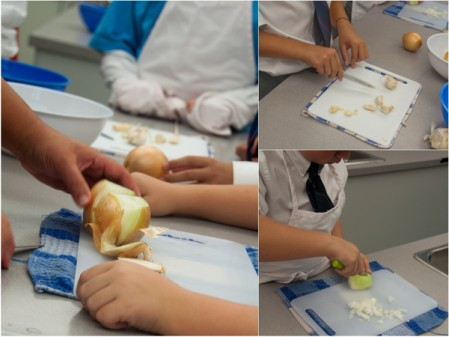Kids chopping onions and garlic with Rossy Earle on eatlivetravelwrite.com