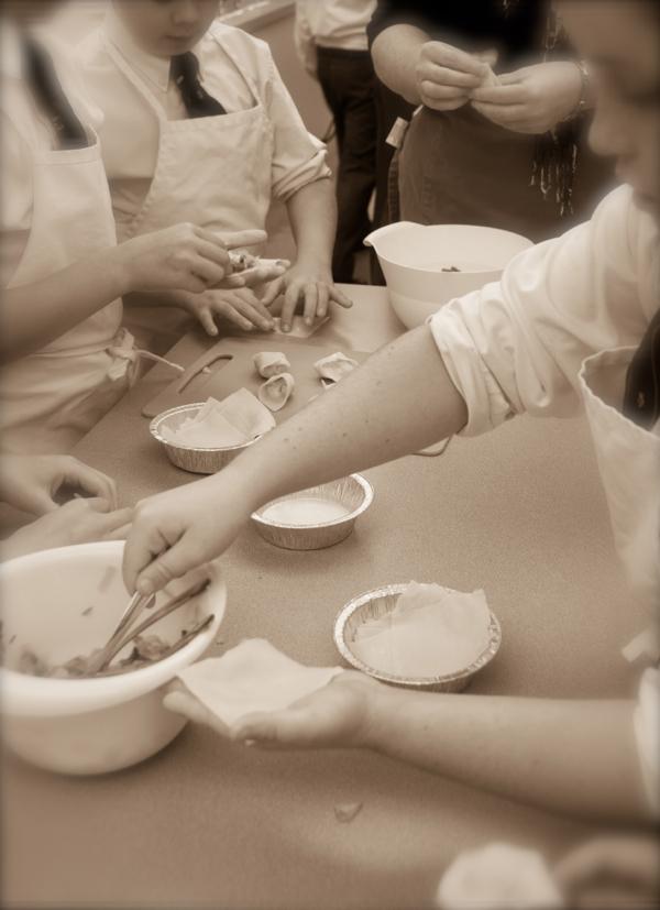 Kids filling Afghan dumplings on eatlivetravelwrite.com