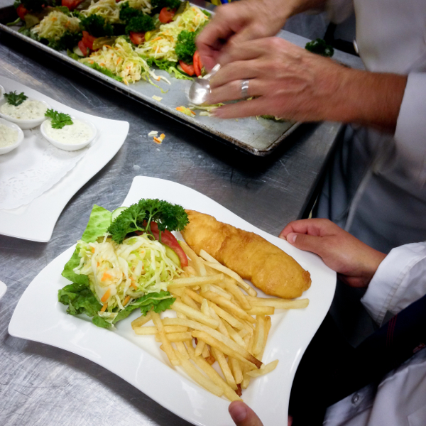 Plating up fish and chips with Chef James Stewart at The National Club on eatlivetravelwrite.com