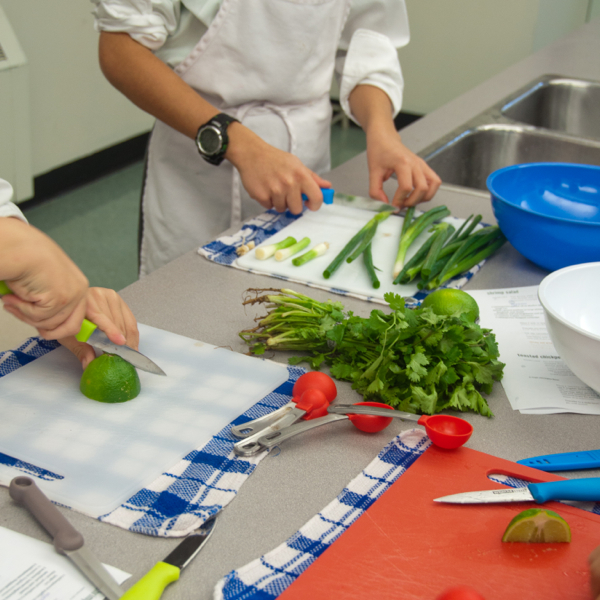 Kids cutting limes and green onions on eatlivetravelwrite.com