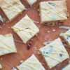 Cranberry shortbread with white chocolate ganache drizzle on eat