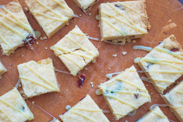 Cranberry shortbread with white chocolate ganache drizzle on eatlivetravelwrite.com