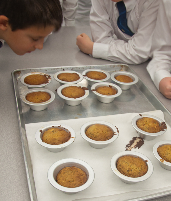 Kids in the kitchen sniffing sticky toffee date pudding on eatlivetravelwrite.com