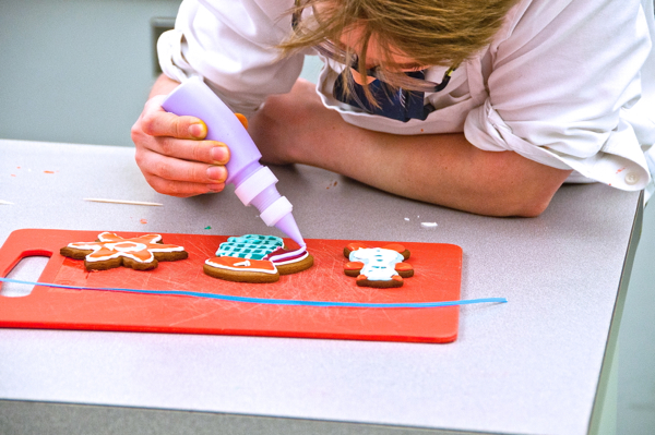 Concentrating on decorating cookies with Adell Shneer on eatlivetravelwrite.com
