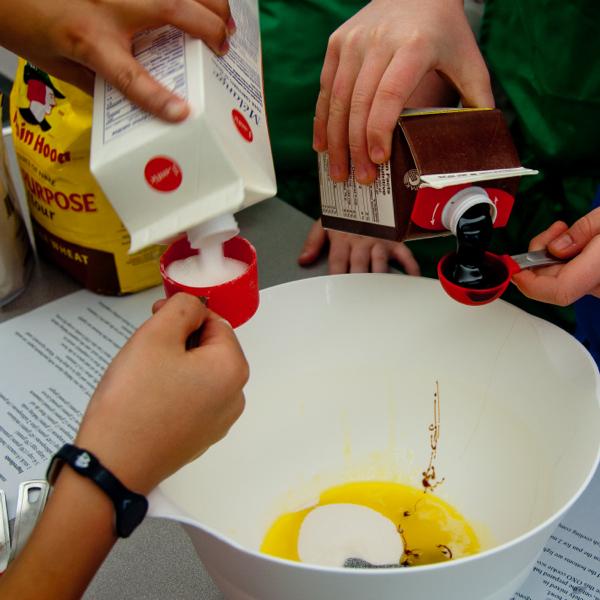 Measuring ingredients for gingersnap cookies on eativetravelwrite.com