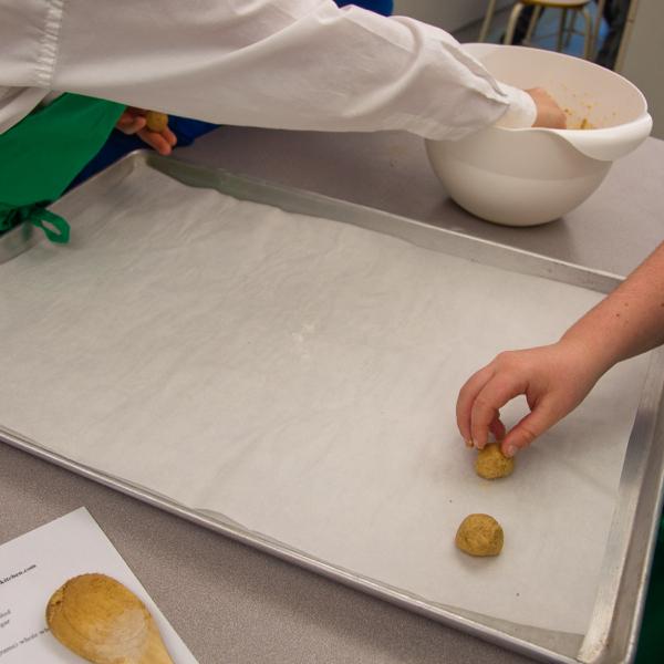 Placing gingersnap cookies on baking trays on eatlivetravelwrite.com