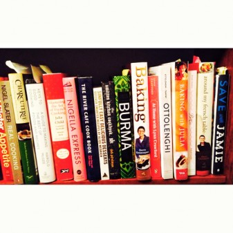 Cookbooks on shelf on eatlivetravelwrite.com