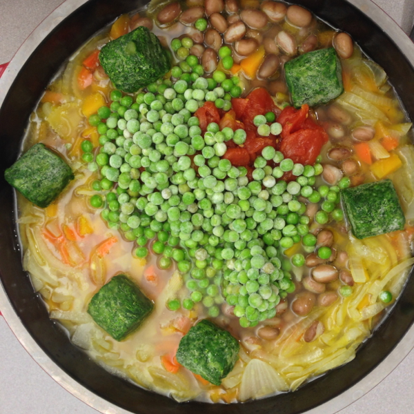 adding veggies to happy frumpy minestrone #savewithJamie on eatlivetravelwrite.com