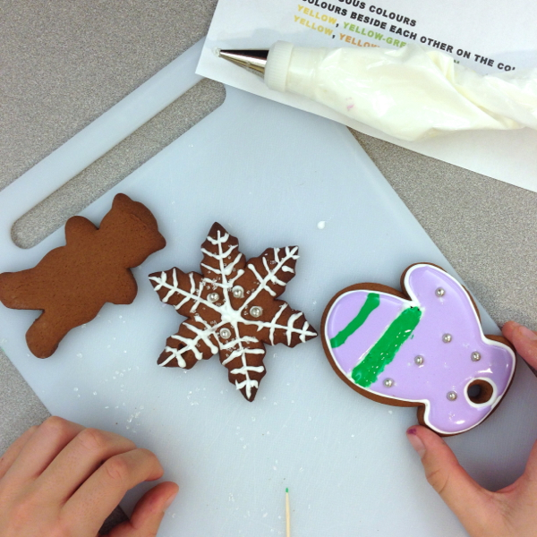 Kids decorating holiday cookies on eatlivetravelwrite.com