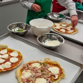Topping Jamie Oliver's Cheat's Pizza on eatlivetravelwrite.com