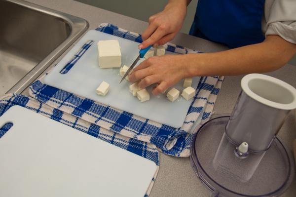 Kids chopping cream cheese for Jamie Oliver's cream cheese pastry on eatlivetravelwrite.com