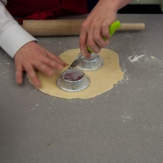 Kids measuring pastry cases for meat pies on eatlivetravelwrite.com