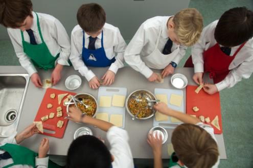 Kids making dumplings on eatlivetravelwrite.com