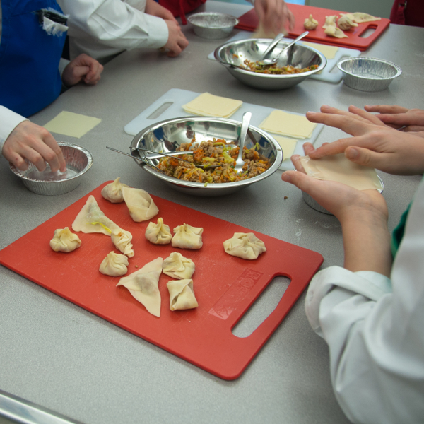 Kids making Jamie Oliver dumplings on eatlivetravelwrite.com